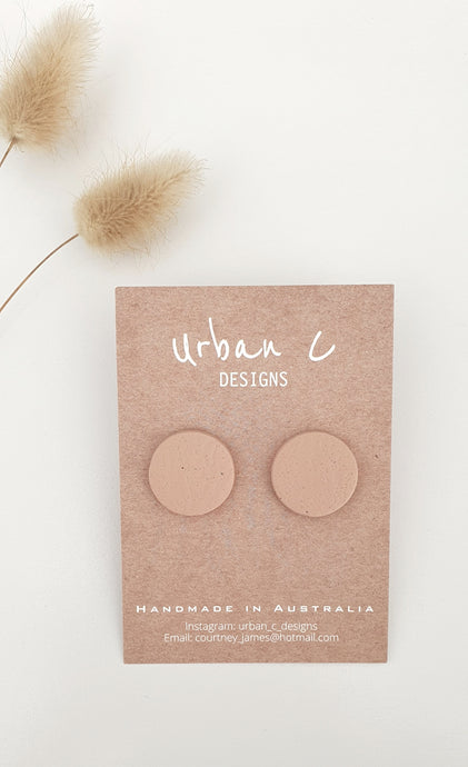 Beautiful handmade studs from Urban C Designs are one of a kind and uniquely made meaning no two are the same.  Each stud is hand pressed, cut, baked, sanded and assembled using polymer clay and hypoallergenic surgical stainless steel.