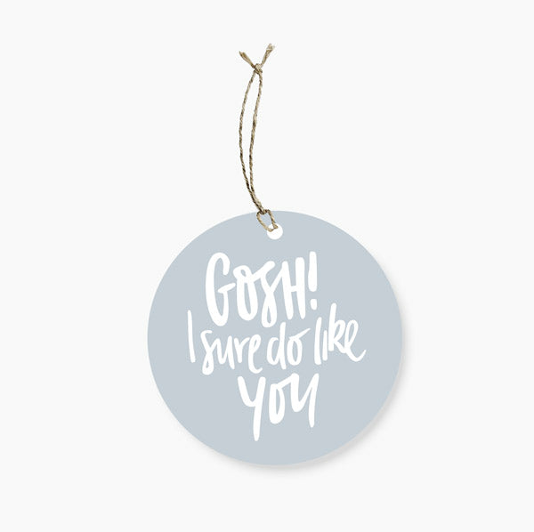 80mm in diameter, with space to write To/From on the back and room to write a special holiday message to the lucky recipient.  Gift tags printed on 100% recycled card with vegetable based inks.  Happily Designed and Printed in Australia.