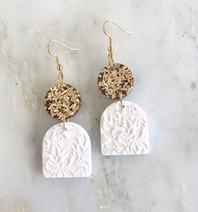 Each earring is hand pressed, cut, baked, sanded and assembled using polymer clay and hypoallergenic surgical stainless steel.