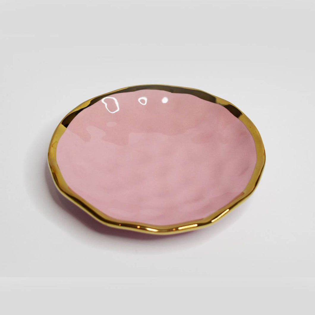 The cutest pastel dishes to keep all of those special little trinkets in!  Each dish has a subtle dimple finish with gold edging.