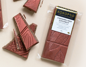 Milk chocolate 38%     Fine European chocolate embedded with caramelised coconut  GLUTEN FREE     50g