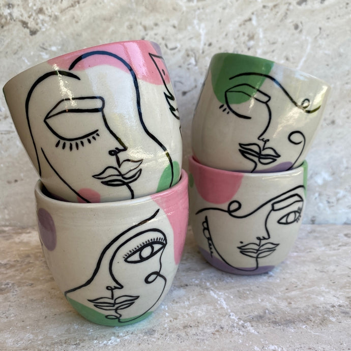 Handmade with love and hand drawn in Australia every side is uniquely beautiful.  All tumblers are sufficiently glazed on the inside and are food safe.  Each piece has its own unique personality, imagine sipping wine or your morning coffee from these pretty ladies.   To ensure that your items remain special, please preference handwashing.     * Tumblers are sold individually   6 oz