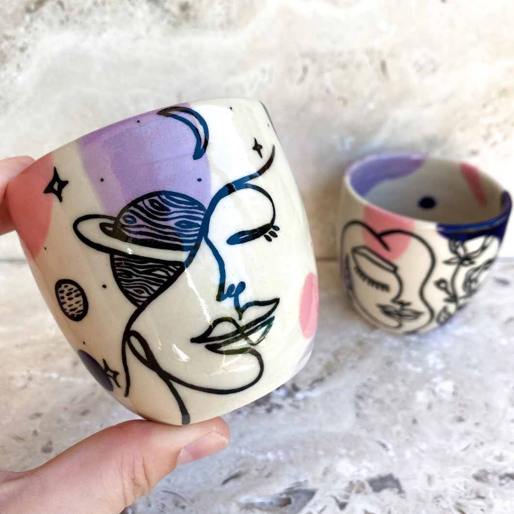 Handmade with love and hand painted in Australia every side is uniquely beautiful.  All tumblers are sufficiently glazed on the inside and are food safe.  Each piece has its own unique personality, imagine sipping wine or your morning coffee from these pretty ladies.  To ensure that your items remain special, please preference handwashing.  * Tumblers are sold individually   6 oz