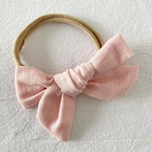 Hair bows for Babies, Toddlers and Kids   Made with the most beautiful linen in dusty pink, this classic bow style comes attached to the softest nylon making them suitable for your little one's head.