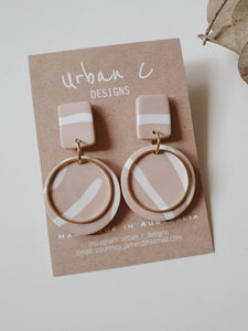These handmade earrings from Urban C Designs are one of a kind and uniquely made meaning no two are the same.  Each earring is hand pressed, cut, baked, sanded and assembled using polymer clay and hypoallergenic surgical stainless steel.