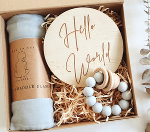 This beautifully packaged gift box includes: Hello world announcement disc, My little giggles teether, Pop Ya Tot swaddle