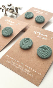 These handmade stud earrings from Urban C Designs are one of a kind and uniquely made meaning no two are the same.  Each earring is hand pressed, cut, baked, sanded and assembled using polymer clay and hypoallergenic surgical stainless steel.