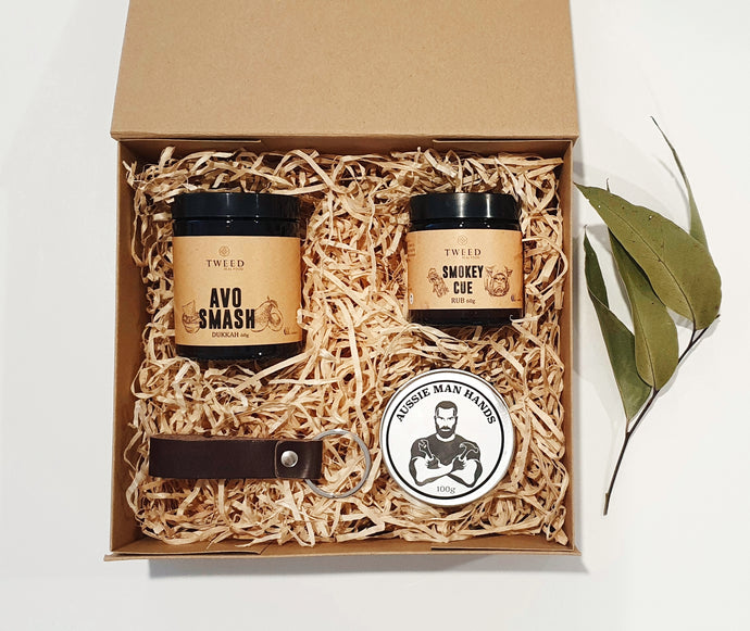 Need an Aussie gift for the Aussie bloke? Why not treat him to this gift box of Aussie made products?  Tweed Real Food Avo Smash Dukkah Tweed Real Food Smokey Cue Meat Rub Leather keyring Aussie Man Hands - Handcream for tradies
