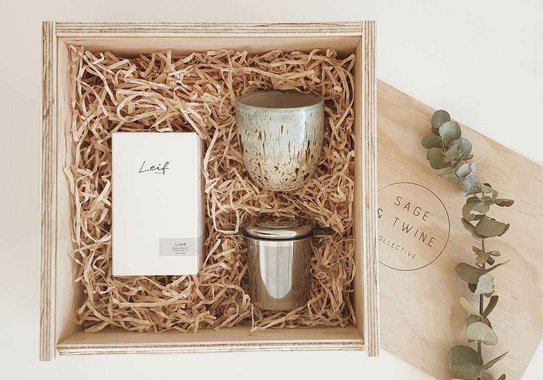 Wooden gift box includes;  Luxe tea is an irresistible touch of luxury to your day. Wonderfully comforting yet stimulating, it will help create beautiful moments that keep you going through the day Miss E Pottery tumbler, handmade with love and hand painted in Australia every side is uniquely beautiful Stainless steel tea infuser, beautiful and functional this infuser is the perfect size for a mug or cup