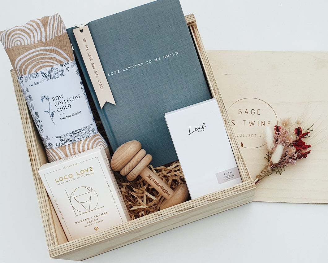 Gift box includes;  Dreamtime organic cotton swaddle Love letters to my child - A delux journal for recording all those precious moments Leather bookmark - handmade & handstamped