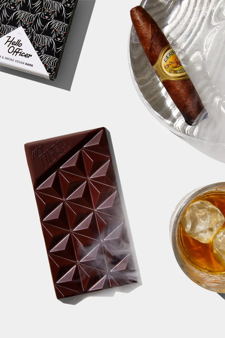 WHISKY & SMOKE  Sometimes a classic is what's in order. Deep dark chocolate spiked with smoke & whisky. Why, Hello Officer!  Handmade in Melbourne, VIC  Ingredients - Dark Chocolate (99%) [cocoa beans, sugar, cocoa butter, emulsifier: soy lecithin, vanilla], Single Malt Whisky Flavour (0.5%) [stabiliser (422), water, colour (150a)]. Scotch Whisky Flavour (0.5%), Smoke Infused Flavour.