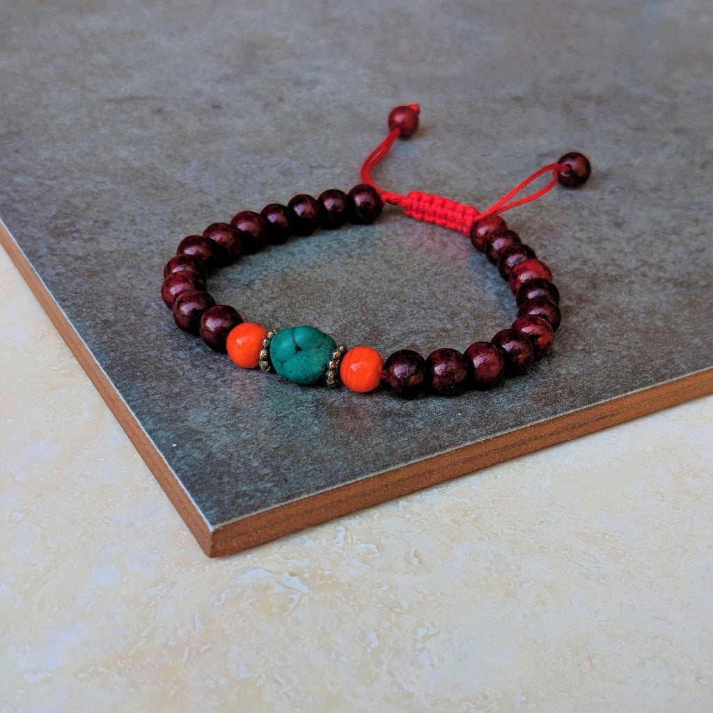 Rosewood Mala Bracelet with Turquoise and Orange Accent Beads.