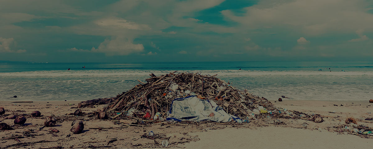 pile of trash next to the ocean