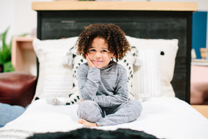 little boy sitting on bed wearing Bamboo Joggers
