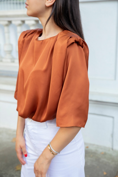 Round neckline ¾ sleeve Relaxed silhouette. Padded shoulders Regular fit  Silky, viscose-mix fabric Smooth with a slight sheen  Main: 70% Cupro, 30% Viscose. Handmade in Turkey