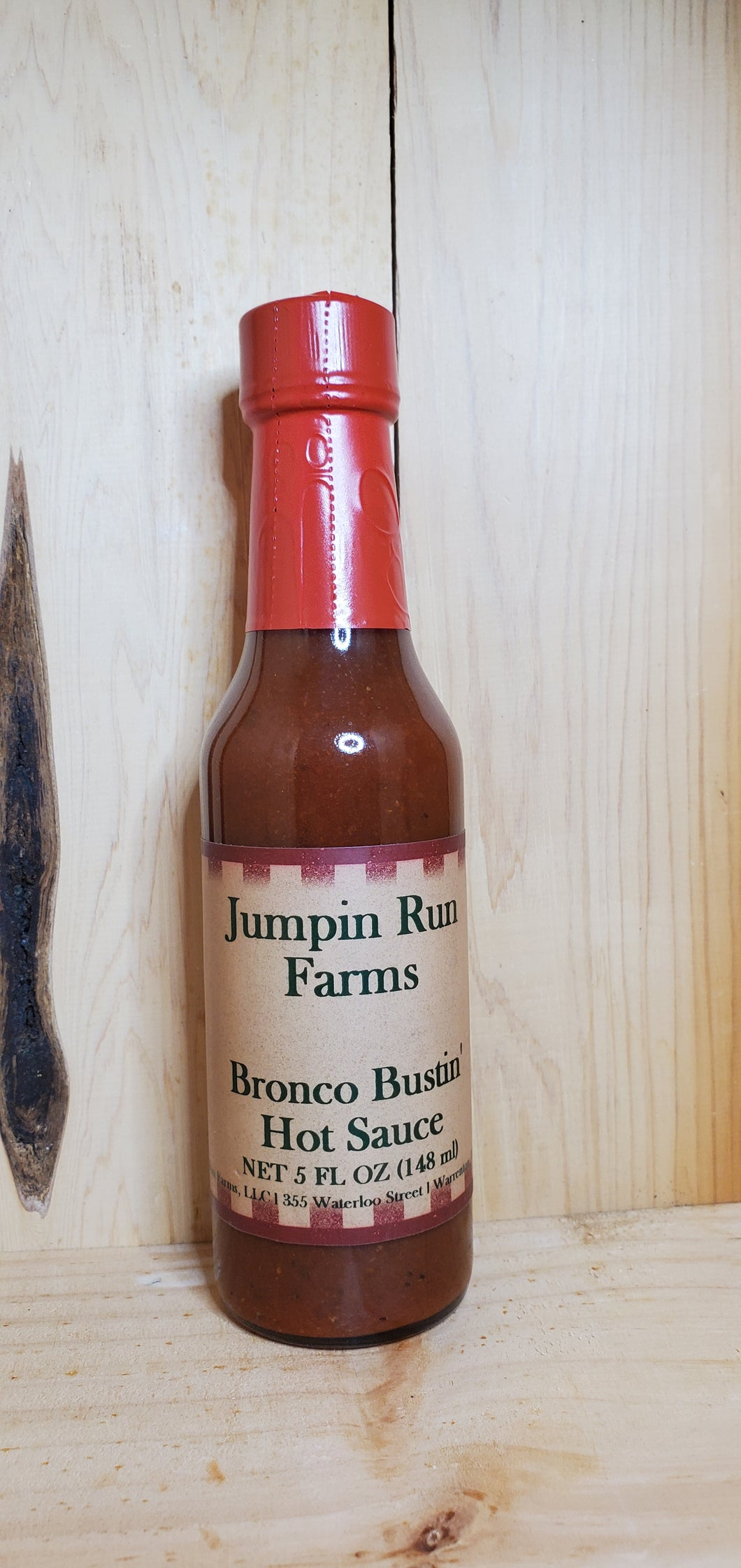 glass bottle of Bronco Bustin Hot sauce