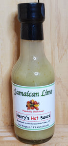 glass bottle with green jamaican lime hot sauce