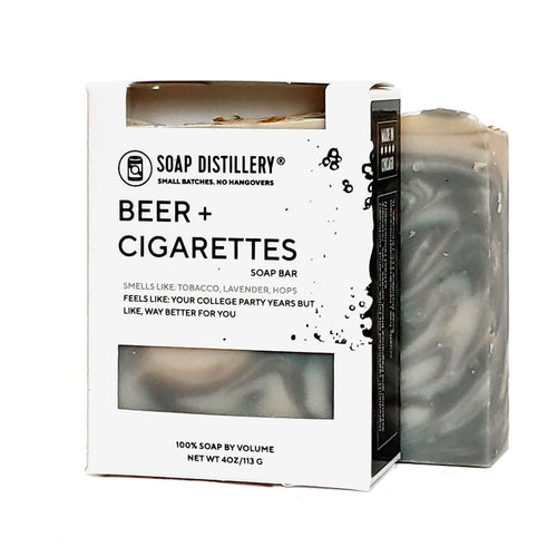 a black swirl bar of soap saying beer and cigarettes smell