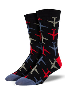 red blue and gray jets atop a black background of socks with a red heel