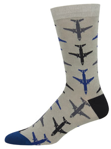 green socks with black, gray and blue jet planes on them. black heal