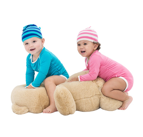 Our Snug-a-licious bubs in aqua and coral onesies