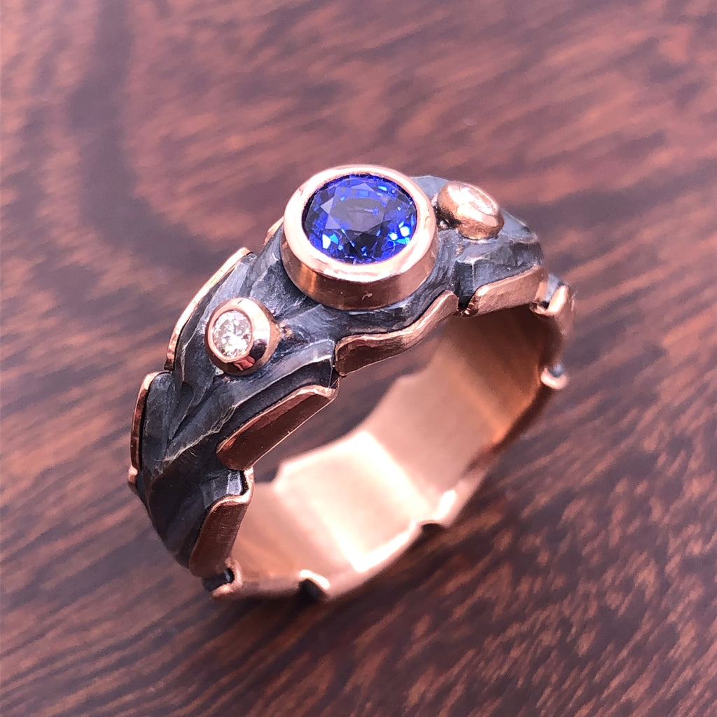 Blue Sapphire (.81ct) in rose gold and sterling oak ring.