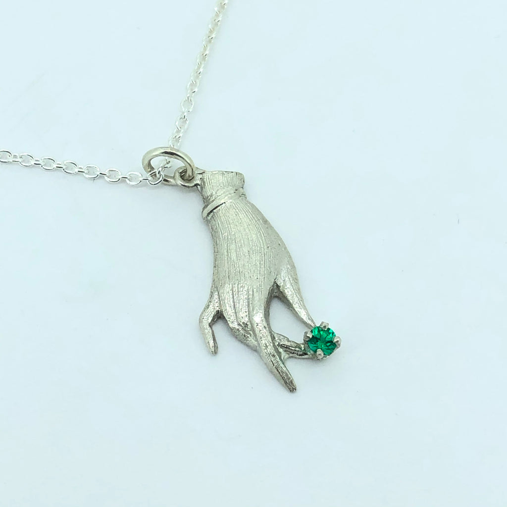 Raymond's hand pendant with synthetic emerald