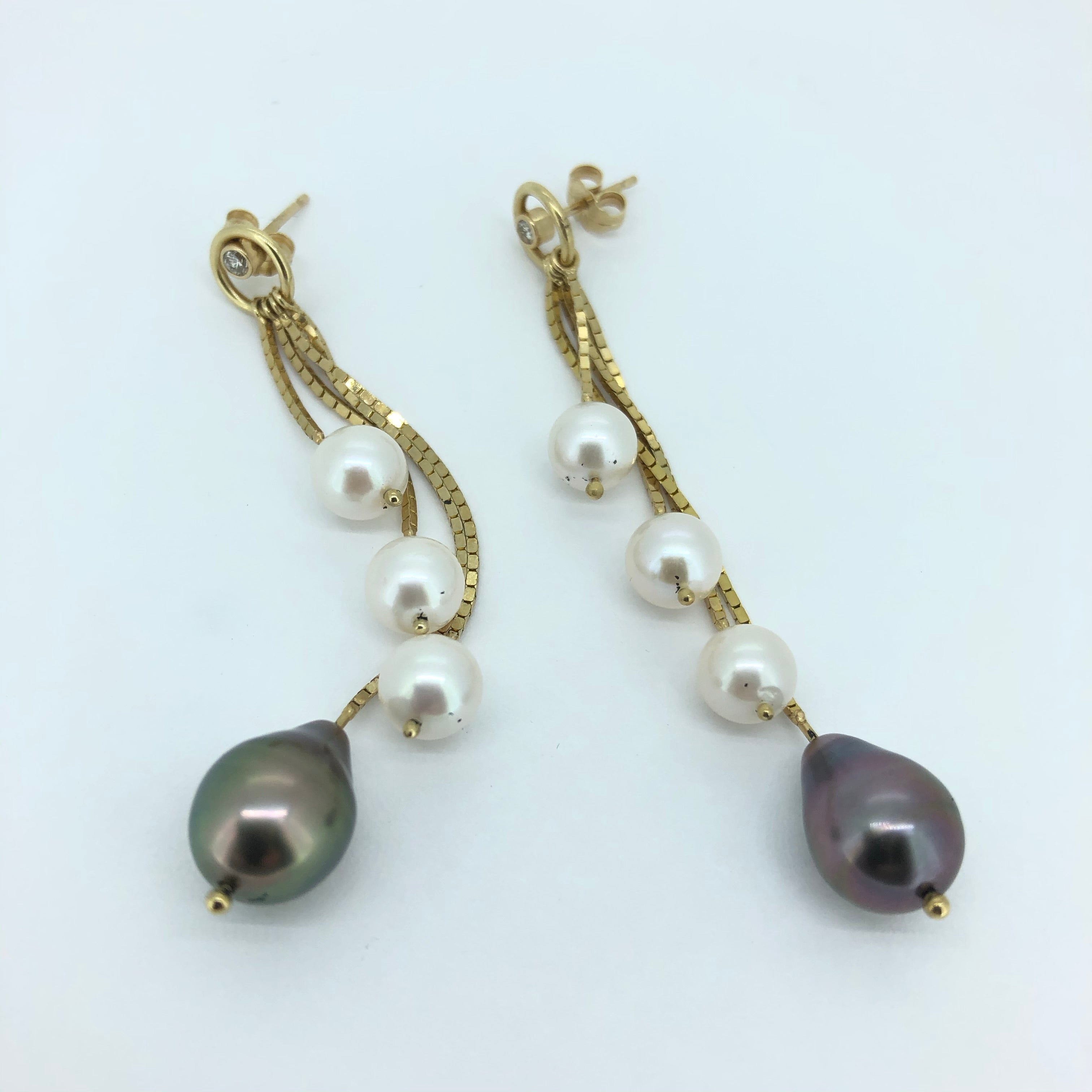 Pearl and 14k yellow gold earrings.