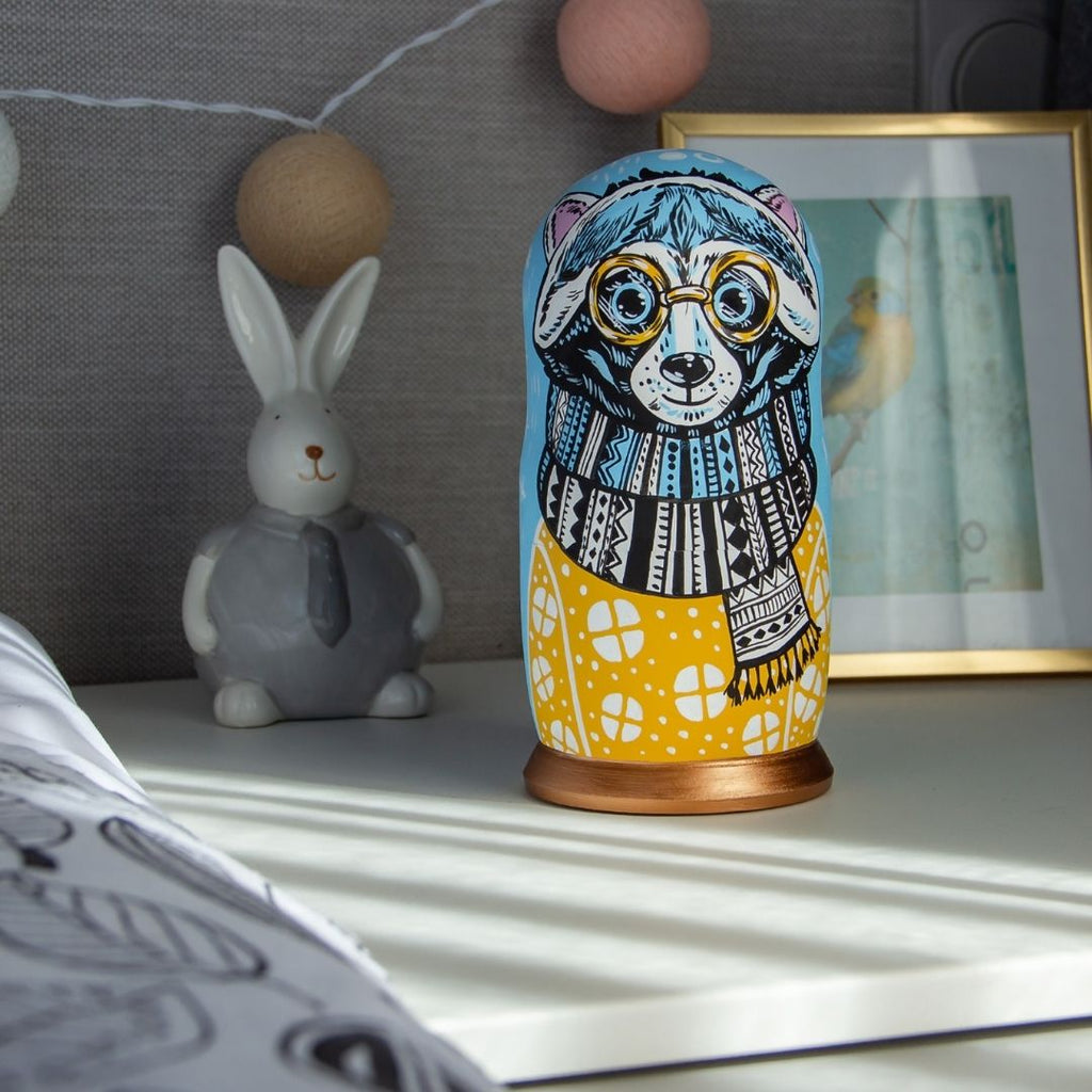 The ambient blue and yellow color combinations of our Raccoon nesting dolls make them a lovely addition to every kid's bedroom.