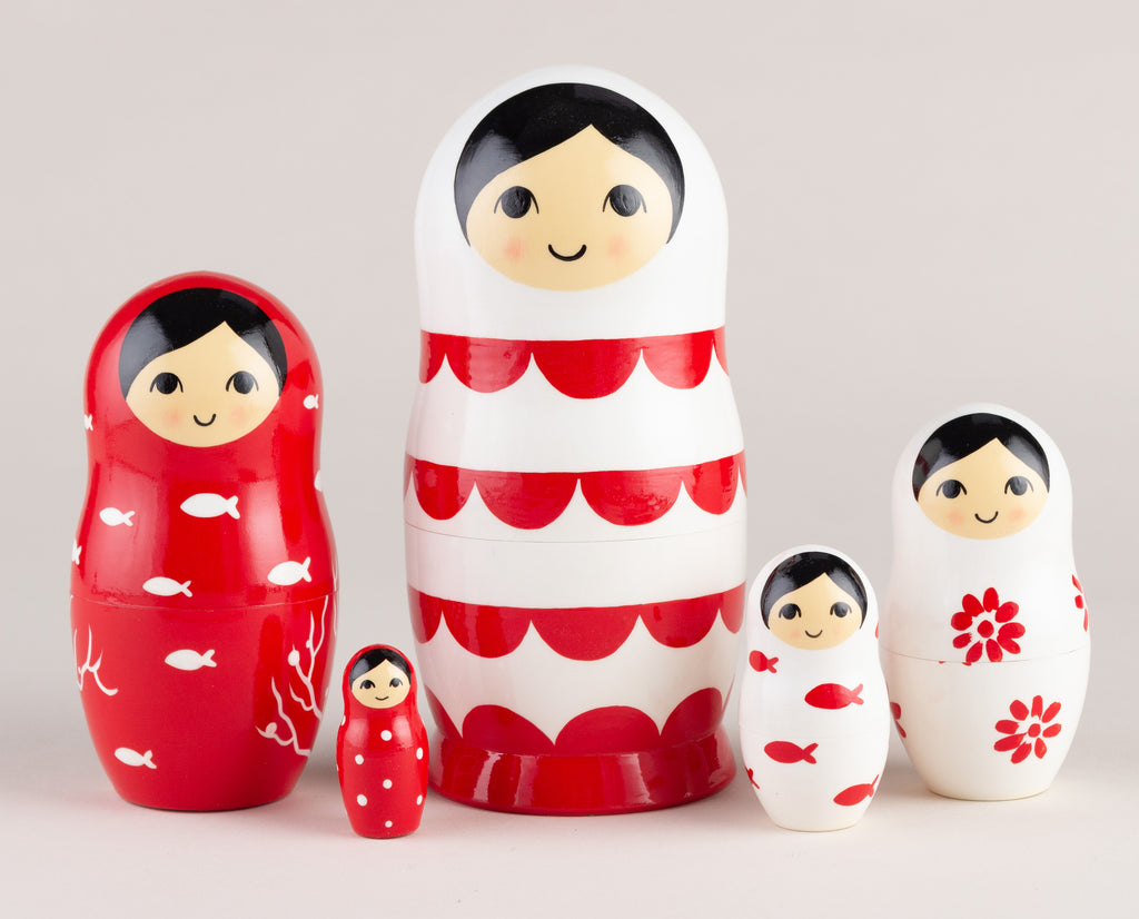 Nesting dolls white and red waves