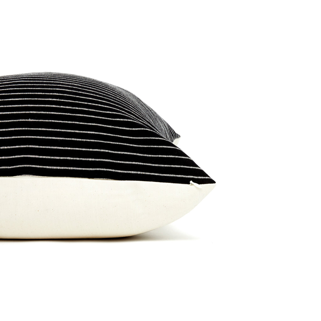 Detail of black with off-white striped long lumbar cotton home goods pilllow