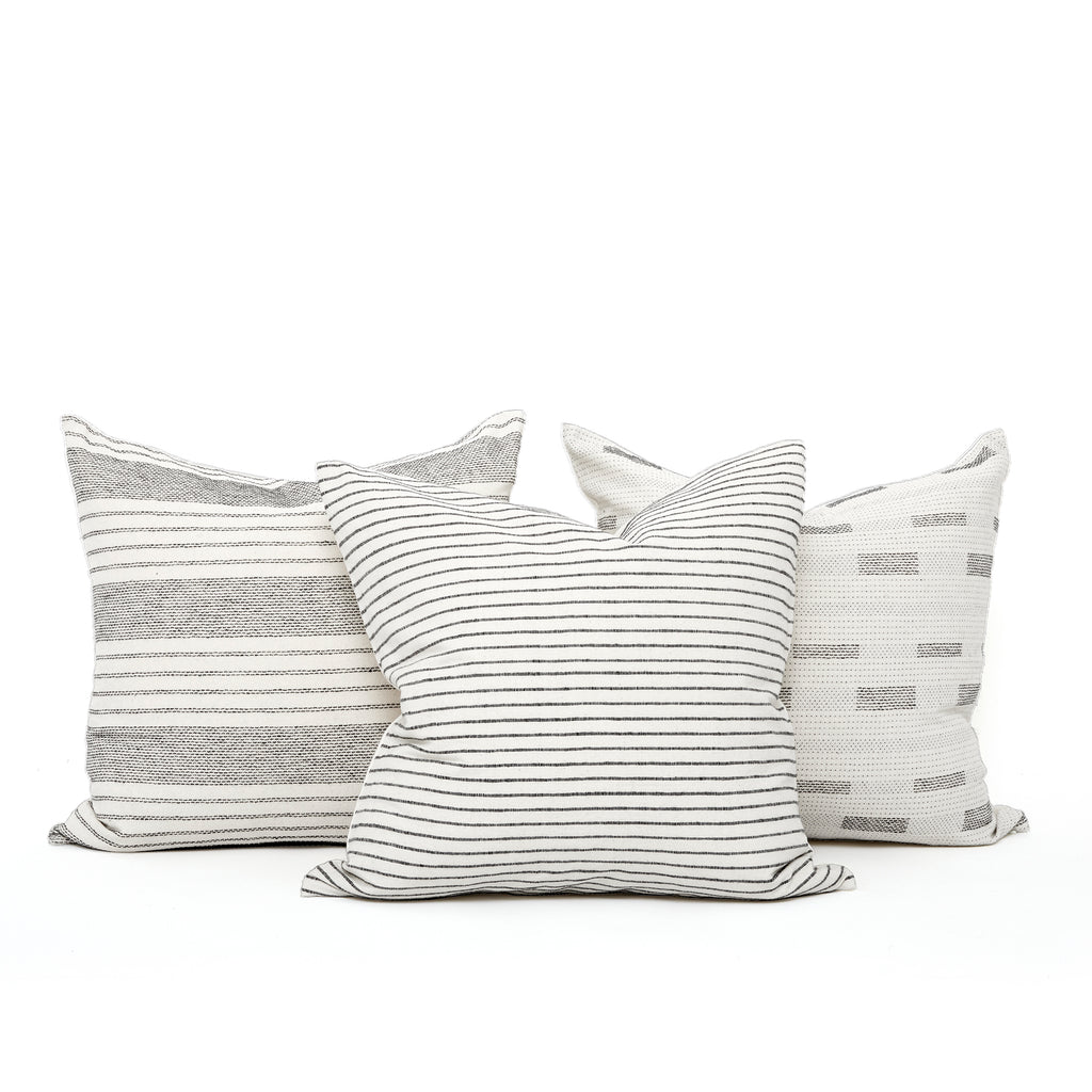 Hidalgo Home off-white pillows mixed and matched for a neutral room decor