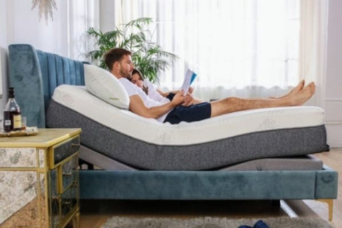 couple laying on adjustable bed