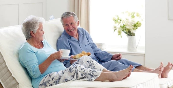 elderly couple relaxing on adjustable bed