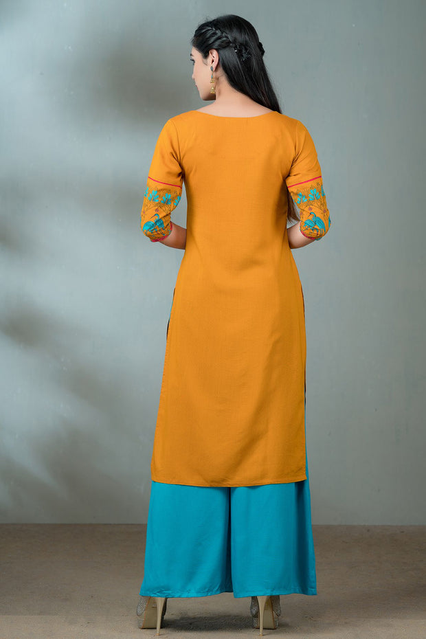 Abstract bird print at the bottom and sleeves- Mustard
