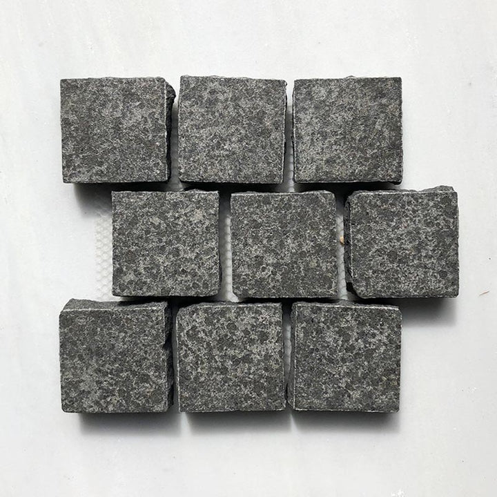 RAVEN BLACK FLAMED COBBLESTONE GRANITE BRICK PATTERN