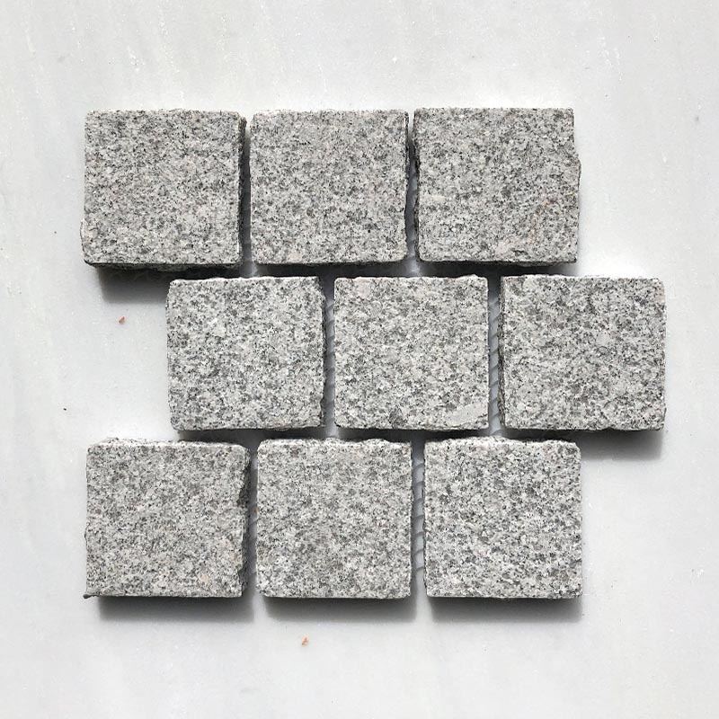SESAME WHITE BUSH HAMMERED COBBLESTONE GRANITE BRICK PATTERN