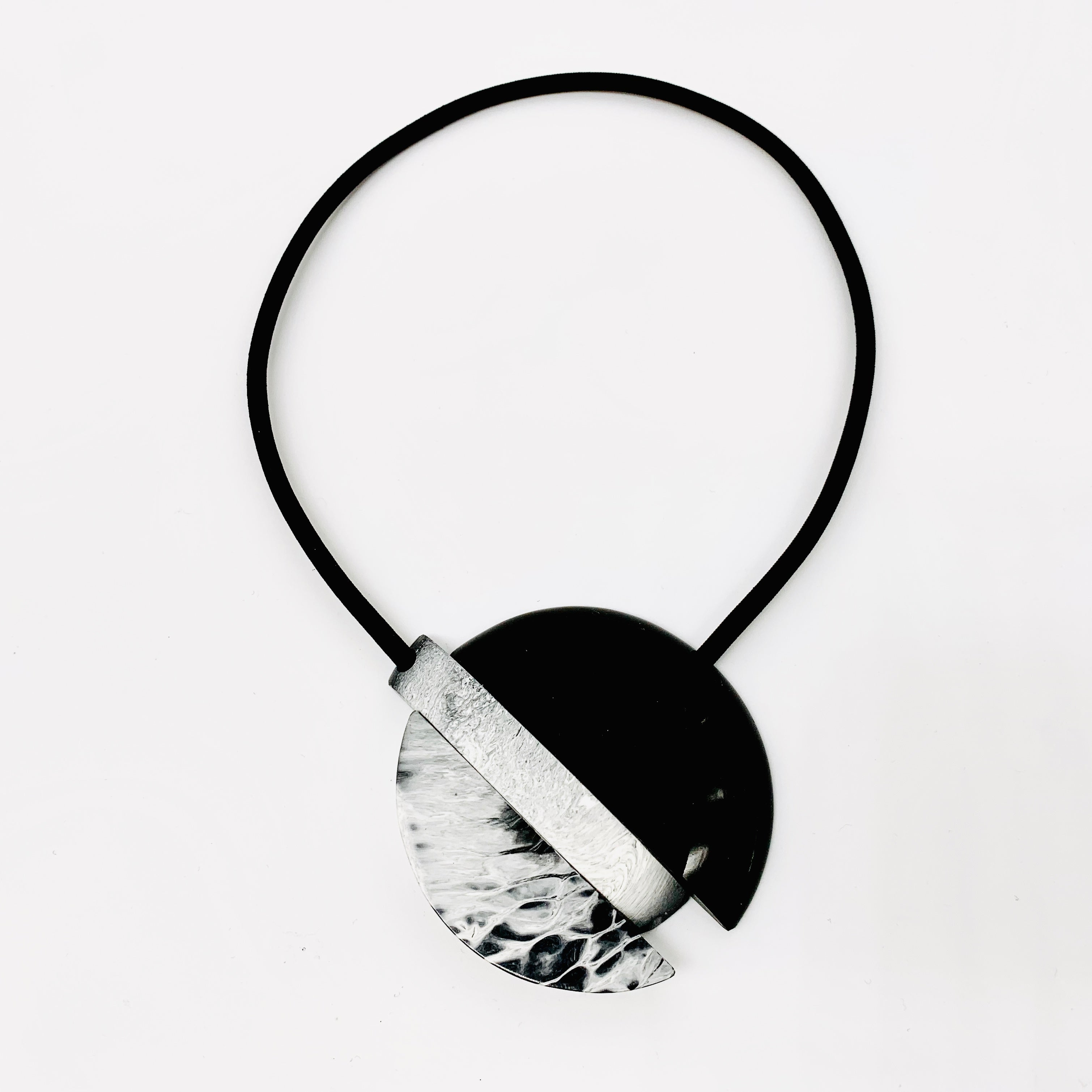 Black half circle with Grey Half Circle on Black Cord