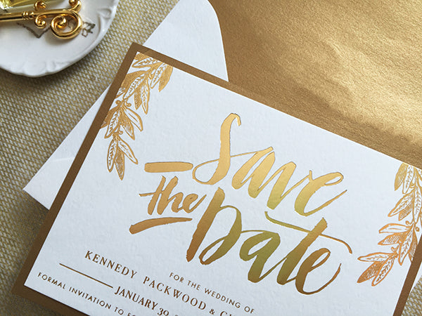 gold foil hand lettered save the date calligraphy