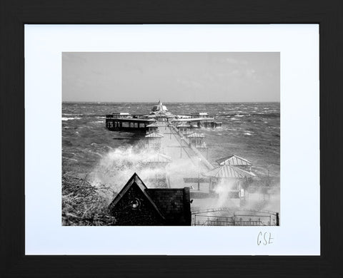 'Stormy Llandudno Pier' print in black-and-white