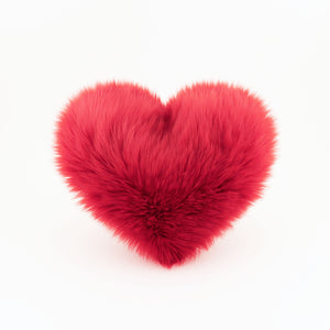 Crimson red faux fur Heart shaped decorative pillow.