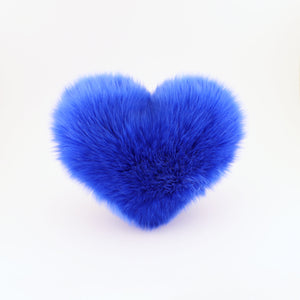 Front view of a Cobalt Blue faux fur heart shaped decorative pillow.