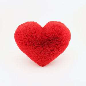 Front view of a Red fluffy plush heart shaped decorative pillow.