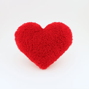 Front view of a Scarlet Red Curly Shag plush heart shaped decorative pillow.