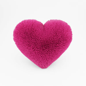 Magenta Heart shaped decorative pillow in fluffy shag material.