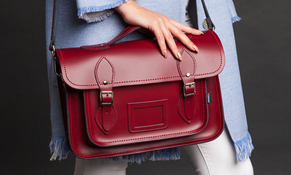Oxblood Red Handmade Leather Satchel helf by woman wearing blue shirt