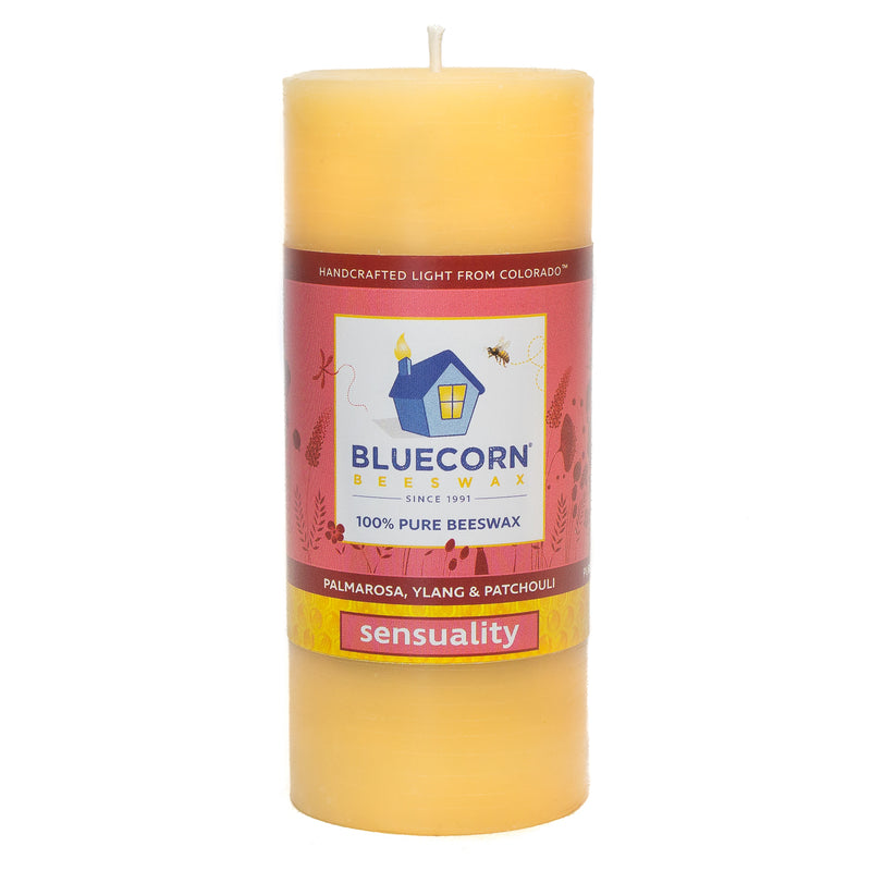 "Sensuality - Palmarosa, Ylang-ylang & Patchouli/ raw beeswax pillar candle scented with essential oils. Yellow candle measures 4.5"" tall and 2"" wide. Wrapped in red Bluecorn Beeswax label,"