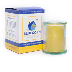 Factory Second 4.4 ounce beeswax candle in 100%  recycled glass. Candle wax is hallmark golden yellow of pure beeswax and the recycled glass is aqua. Candle may have a bubble or scratch, hence its discounted price in the clearance section.