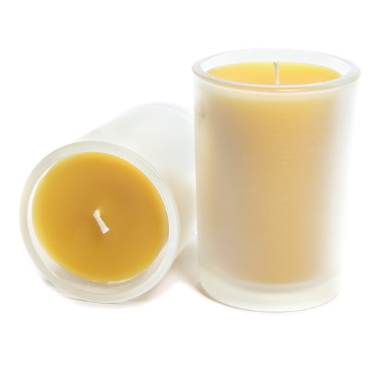 Two beeswax candles in frosted glass depicting the side and top view of Bluecorn Beeswax's 8.5oz  pure beeswax candle. Wax is golden yellow and shows through only slightly in the frosted glass.