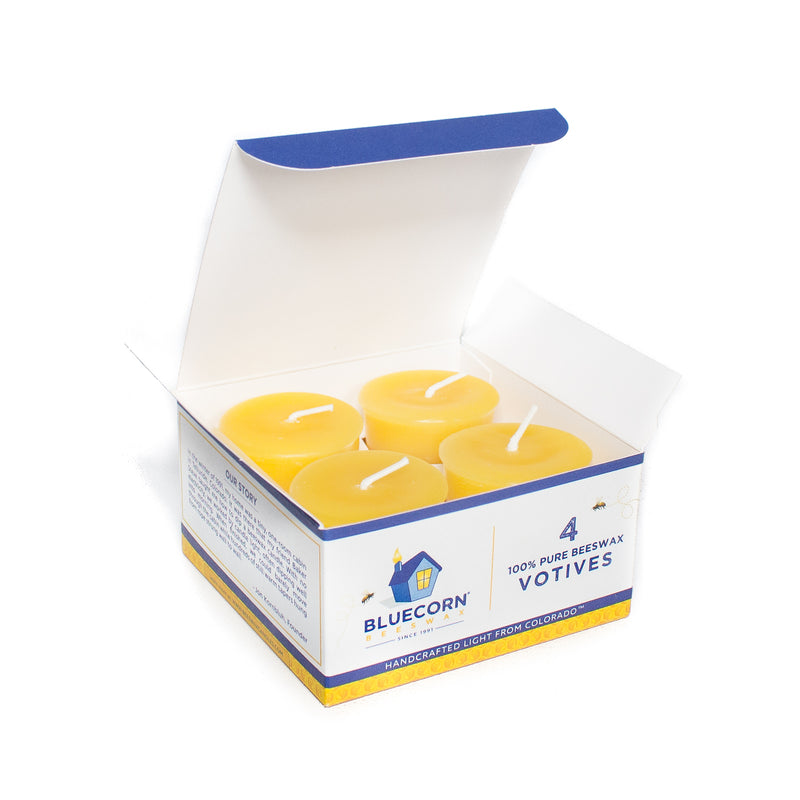 Bluecorn Beeswax 4-pack votive box open to reveal the golden yellow candles within.